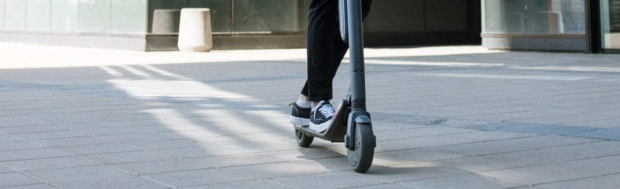 Man Riding an Electrical Scooter